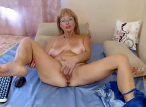 Mature dame pounds herself by  on web..