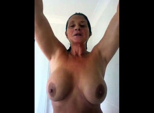 Huge-chested  taking a shower. Looks..