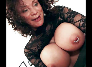 Playful grannie with ginormous pierced..